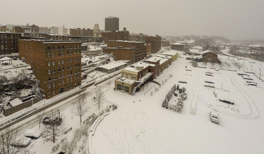 An aerial view of downtown Lynchburg as the snow falls Saturday, Jan. 7, 2017, in Lynchburg, Va. The snow has moved out of Virginia, but police say driving conditions remain dangerous and are encouraging people to stay off the roads. (Photo by Jay Westcott/News & Daily Advance via AP)