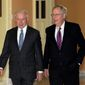 In this file photo from January 2017, then-Sen. Jeff Sessions walks with Senate Majority Leader Mitch McConnell on Capitol Hill. Mr. McConnell has said Mr. Sessions made the right call to recuse himself from Justice Department investigations centered on Russia's meddling in the 2016 U.S. presidential election. (Associated Press) **FILE**