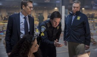 """In this image released by CBS Films, Kevin Bacon, standing from left, Mark Wahlberg and John Goodman appear in a scene from """"Patriots Day."""" (Karen Ballard/CBS Films and Lionsgate Films via AP)"""