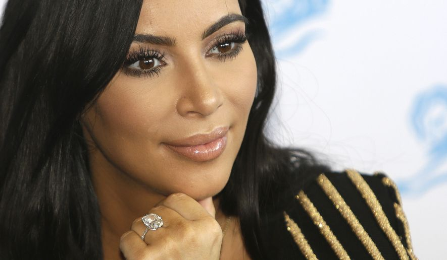 In this June 24, 2015, file photo, American TV personality Kim Kardashian attends the Cannes Lions 2015, International Advertising Festival in Cannes, southern France. Paris police Monday Jan.9, 2017 say 16 people have been arrested over Kim Kardashian jewelry heist. (AP Photo/Lionel Cironneau, File)