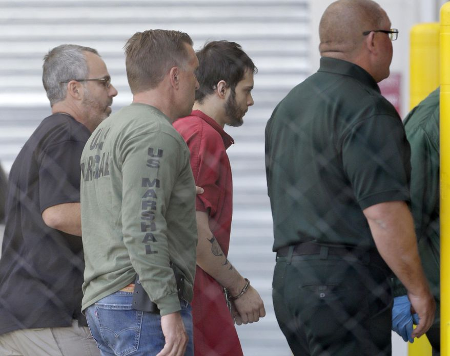 Esteban Santiago, third from left, accused of fatally shooting several people and wounding multiple others at a crowded Florida airport baggage claim, is returned to Broward County's main jail after his first court appearance, Monday, Jan. 9, 2017, in Fort Lauderdale, Fla. (AP Photo/Alan Diaz)