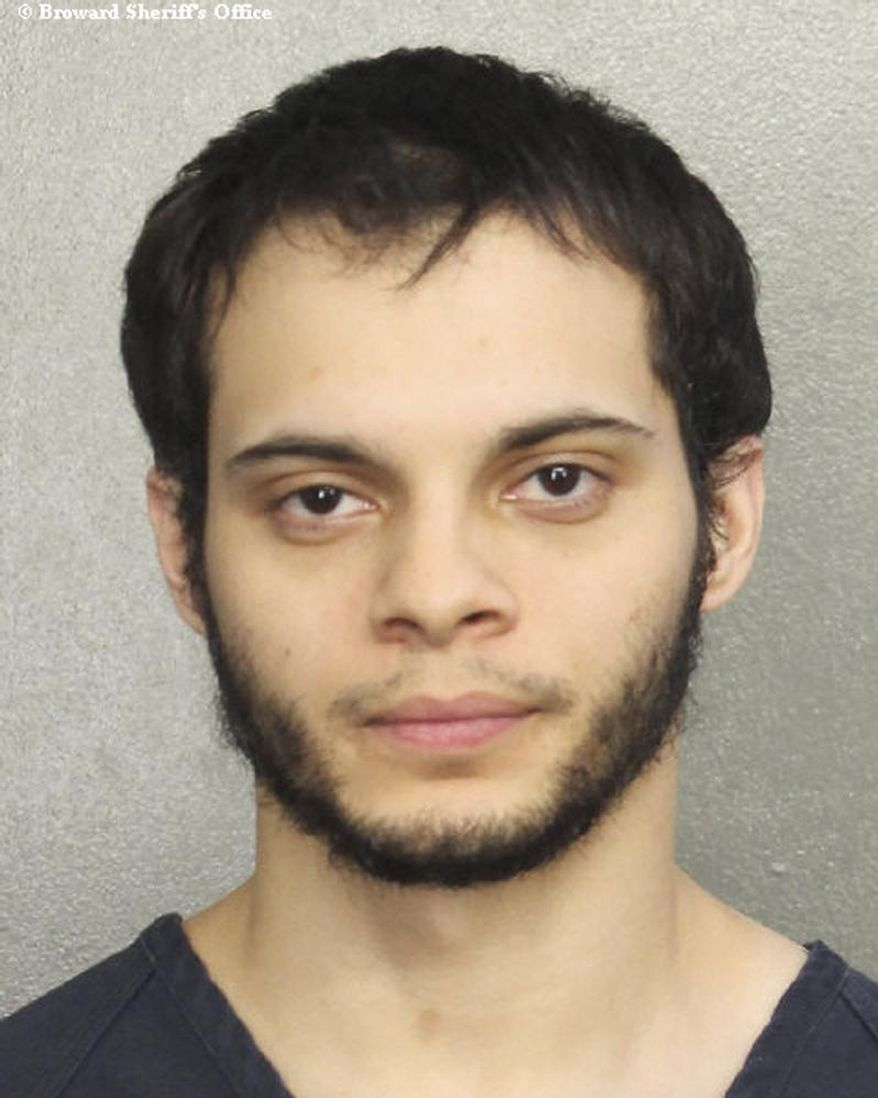 This file booking photo provided by the Broward Sheriff's Office shows suspect Esteban Santiago in Fort Lauderdale, Fla. Santiago, the Iraq war veteran accused of fatally shooting multiple people and wounding several others at a crowded Florida airport baggage claim, is due for his first court appearance Monday, Jan. 9, 2017. (Broward Sheriff's Office via AP)