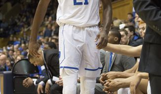 Duke's Amile Jefferson (21) leaves the bench after injuring his foot during the first half of an NCAA college basketball game against Boston College in Durham, N.C., Saturday, Jan. 7, 2017. Duke defeated Boston College 93-82. (AP Photo/Ben McKeown)