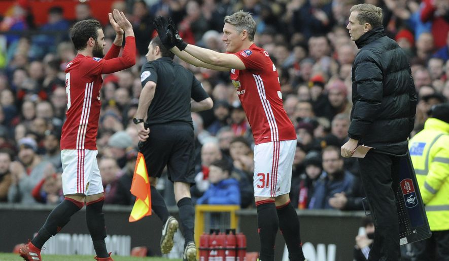 Manchester United's Bastian Schweinsteiger, (31) comes on as a substitute to replace United's Juan Mata during the English FA Cup Third Round match between Manchester United and Reading at Old Trafford in Manchester, England, Saturday, Jan. 7, 2017. (AP Photo/Rui Vieira)