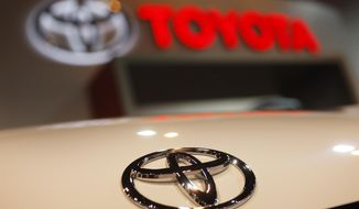 FILE - In this April 17, 2010 file photo, a Toyota emblem is seen on a car during the Denver Auto Show in Denver. A much-anticipated revamp of the Toyota Camry will be unveiled Monday, Jan. 9, 2017. (AP Photo/David Zalubowski, File)