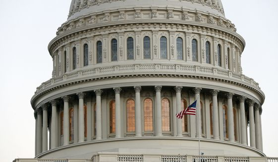 The American flag flies in front of the U.S. Capitol dome at sunset on Capitol Hill in Washington in this Nov. 18, 2016, file photo. (AP Photo/Alex Brandon, file)