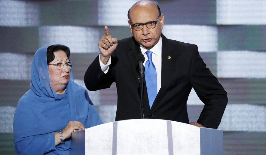 """FILE- In this July 28, 2016, file photo, Khizr Khan, father of fallen US Army Capt. Humayun S. M. Khan, accompanied by his wife Ghazala at the Democratic National Convention in Philadelphia. Khan says in a letter Monday, Jan. 9, 2017, to leaders of the Republican-led Senate Judiciary Committee that Sen. Jeff Sessions, an Alabama Republican, won't protect the """"sacred right"""" of Americans to vote. (AP Photo/J. Scott Applewhite, File)"""