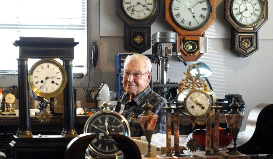 In this Nov. 11, 2016 photo, Harrison Parks, 101, sits in his Dunlap clock shop In  Dunlap, Ill. Parks and his son Morry Parks were instrumental in repairing and modifying the old Peoria County Courthouse clock from 1878, and campaigning to get it installed at the Peoria Riverfront Museum in Peoria, Ill. (Leslie Renken/Journal Star via AP)