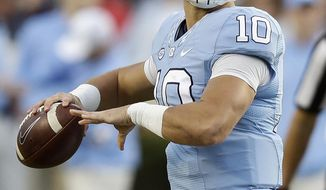FILE - In this Nov. 19, 2016, file photo, North Carolina quarterback Mitch Trubisky (10) looks to pass against The Citadel during the first half of an NCAA college football game in Chapel Hill, N.C. Trubisky said Monday, Jan. 9, 2017, that he plans to skip his senior season and enter the NFL draft. (AP Photo/Gerry Broome, File)