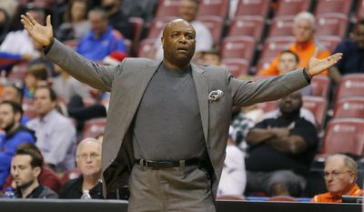 FILE - In this Dec. 17, 2016, file photo, Florida State coach Leonard Hamilton reacts as his team plays Manhattan during an NCAA college basketball game in the Orange Bowl Classic tournament in Sunrise, Fla. Florida State's men's and women's basketball teams are both in the top 10, which marks the first time in school history they have been that highly ranked at the same time.  (AP Photo/Joe Skipper, File)