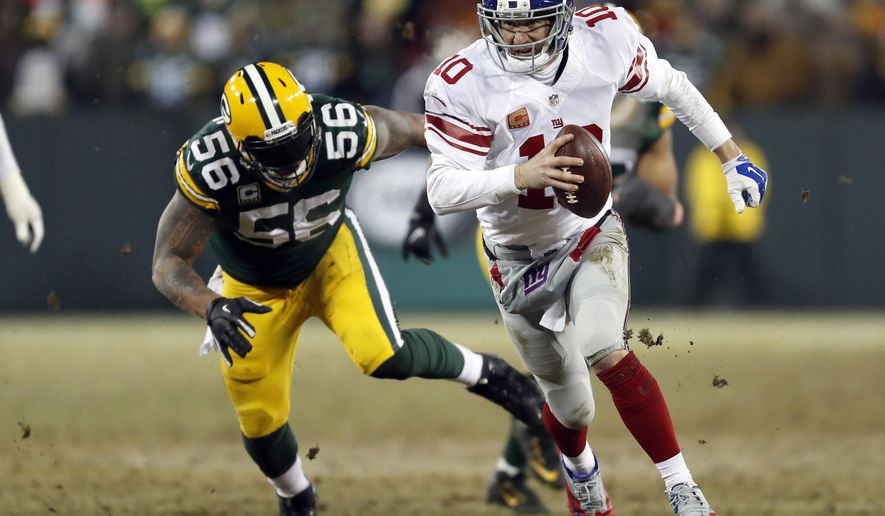 New York Giants quarterback Eli Manning (10) runs against Green Bay Packers outside linebacker Julius Peppers (56) during the second half of an NFC wild-card NFL football game, Sunday, Jan. 8, 2017, in Green Bay, Wis. The Packers won 38-13. (AP Photo/Matt Ludtke)
