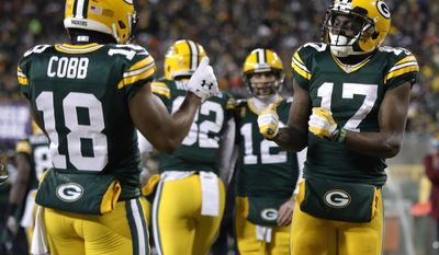 Green Bay Packers wide receiver Davante Adams (17) celebrates with wide receiver Randall Cobb (18) after making a touchdown reception during the first half of an NFC wild-card NFL football game against the New York Giants, Sunday, Jan. 8, 2017, in Green Bay, Wis. (AP Photo/Mike Roemer)