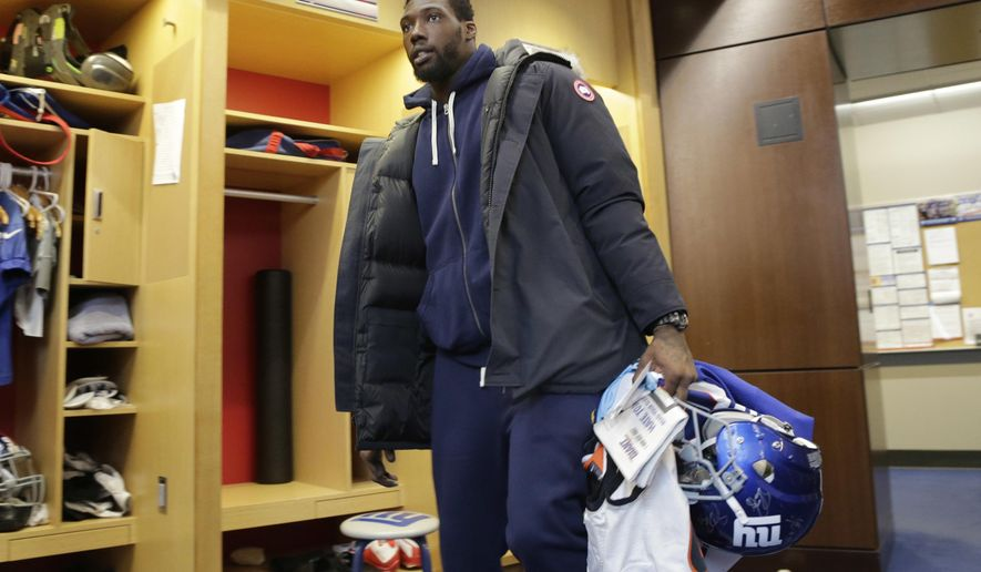 New York Giants defensive end Jason Pierre-Paul takes some of his gear out of the NFL football team's locker room in East Rutherford, N.J., Monday, Jan. 9, 2017. (AP Photo/Seth Wenig)