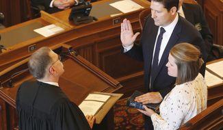 Representative Ron Ryckman (R-Olathe) is sworn in as Speaker of the House Monday, Jan. 9, 2017, by Kansas Supreme Court Justice Lawton Nuss. Rickman's wife Kim is holding the bible. (Bo Rader/The Wichita Eagle via AP)