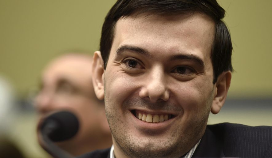 FILE - In this Feb. 4, 2016 file photo, Pharmaceutical chief Martin Shkreli smiles on Capitol Hill in Washington during the House Committee on Oversight and Reform Committee hearing on his former company's decision to raise the price of a lifesaving medicine. Twitter cited harassment when asked Jan. 9, 2017, why Shkreli's account had been suspended from the platform. (AP Photo/Susan Walsh, File)