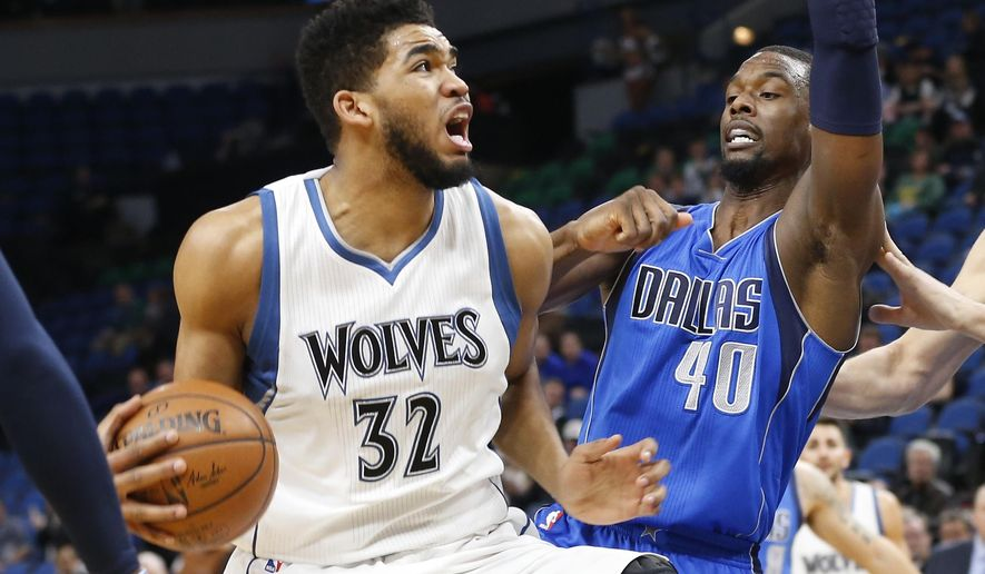 Minnesota Timberwolves' Karl-Anthony Towns, left, eyes the basket as he drives around Dallas Mavericks' Harrison Barnes during the first quarter of an NBA basketball game Monday, Jan. 9, 2017, in Minneapolis. (AP Photo/Jim Mone)