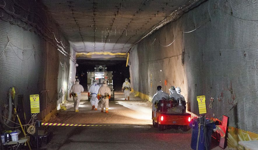 This Jan. 4, 2017, image provided by the U.S. Energy Department and its contractor Nuclear Waste Partnership shows workers moving waste underground at the Waste Isolation Pilot Plant near Carlsbad, N.M. The repository, the federal government's only underground spot for disposing of low-level nuclear waste, had been shuttered for nearly three years since a 2014 radiation release. (Sam Christensen/Nuclear Waste Partnership via U.S. Energy Department)