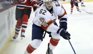 Florida Panthers center Denis Malgin (62) chases the puck during the first period of an NHL hockey game against the New Jersey Devils Monday, Jan. 9, 2017, in Newark, N.J. (AP Photo/Mel Evans)