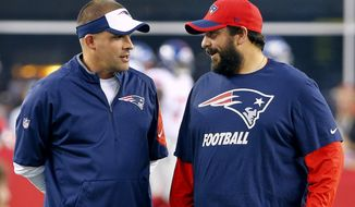 FILE - In this Sept. 3, 2015, file photo, New England Patriots offensive coordinator Josh McDaniels, left, talks with defensive coordinator Matt Patricia before an NFL football game against the New York Giants in Foxborough, Mass. The Patriots coordinators acknowledged Monday, Jan. 9, 2017, that they had participated in interviews about head coaching vacancies over the weekend, but neither specified which teams they met with. (AP Photo/Winslow Townson, File)