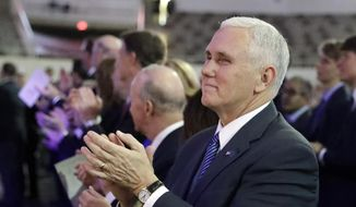 Vice President-elect Mike Pence applauds during the inaugural ceremony for Indiana's statewide office holders, Monday, Jan. 9, 2017, in Indianapolis. (AP Photo/Darron Cummings, Pool) ** FILE **