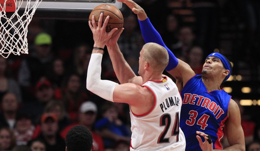 Portland Trail Blazers center Mason Plumlee, left, shoots as Detroit Pistons forward Tobias Harris defends during the first half of an NBA basketball game in Portland, Ore., Sunday, Jan. 8, 2017. (AP Photo/Steve Dipaola)