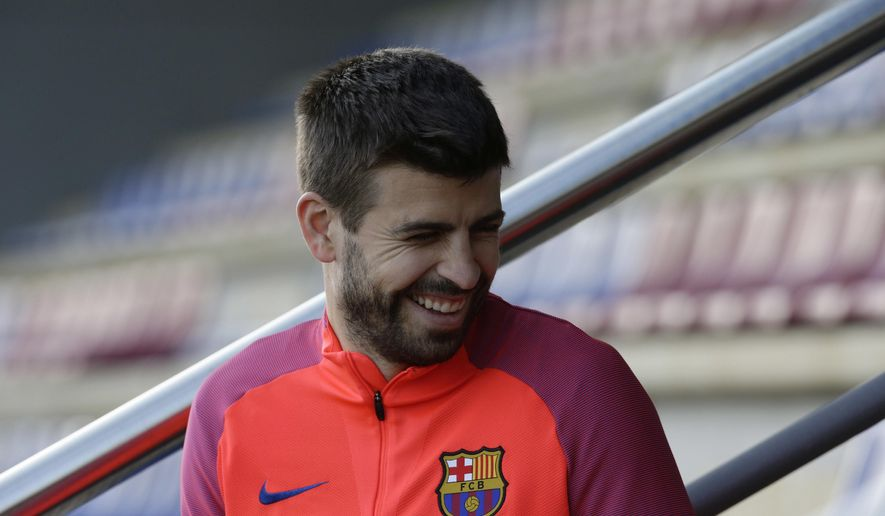 FC Barcelona's Gerard Pique smiles during a training session at the Sports Center FC Barcelona Joan Gamper in Sant Joan Despi, Spain, Saturday, Jan. 7, 2017. Villarreal will play against FC Barcelona in a Spanish La Liga on Sunday. (AP Photo/Manu Fernandez)
