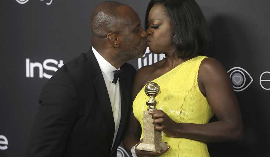 "Viola Davis, right, winner of the award for best performance by an actress in a supporting role in a motion picture for ""Fences,"" kisses Julius Tennon as they arrive at the InStyle and Warner Bros. Golden Globes afterparty at the Beverly Hilton Hotel on Sunday, Jan. 8, 2017, in Beverly Hills, Calif. (Photo by Matt Sayles/Invision/AP)"