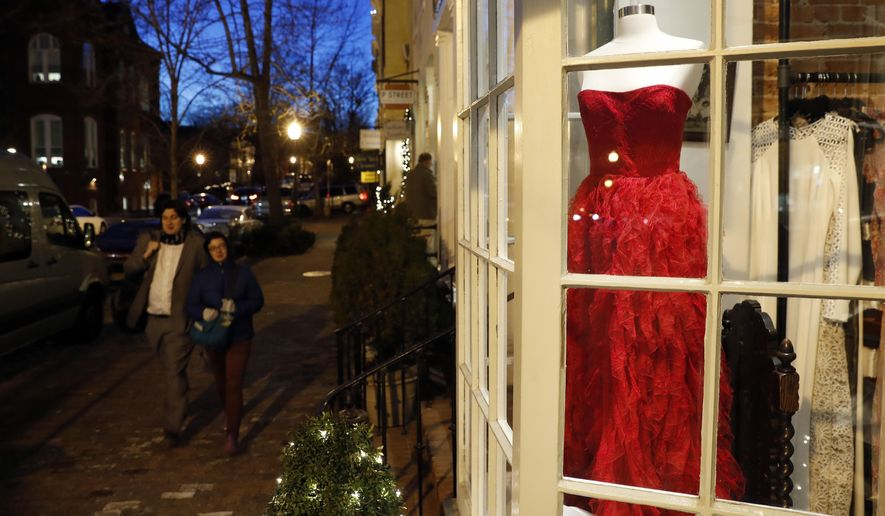 "Designer dresses are for sale at Ella-Rue including this red Badgley Mischka for $795 seen in the window, Monday, Jan. 9, 2017 in the Georgetown area of Washington.  Ladies in Washington planning to celebrate Donald Trump's inauguration as the next president won't, it turns out, need a fairy godmother to find something to wear. The president-elect told The New York Times in an interview published Monday that enthusiasm was so high for the arrival of his administration that turnout for the Jan. 20 events will be ""unbelievable, perhaps record-setting."" ""We've definitely had a lot of people come in in the last week for gowns, but we have plenty here,"" said Krista Johnson, owner of Ella-Rue. (AP Photo/Alex Brandon)"