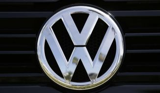 In this Sept. 21, 2015, file photo, a Volkswagen logo is seen on car offered for sale at New Century Volkswagen dealership in Glendale, Calif. The Volkswagen executive, Oliver Schmidt, who once was in charge of complying with U.S. emissions regulations has been arrested in connection with the company's emissions-cheating scandal, a person briefed on the matter said Monday, Jan. 9, 2017. (AP Photo/Damian Dovarganes, File)