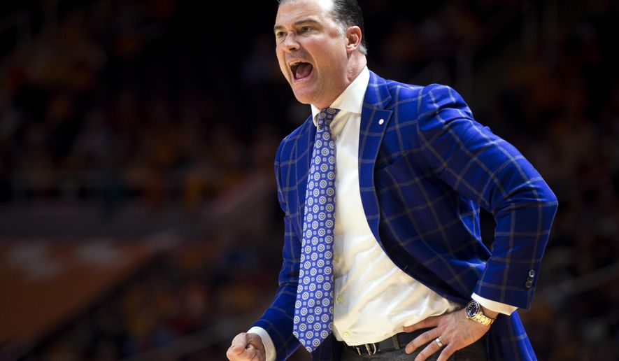 FILE - In this Jan. 1, 2017, file photo, Kentucky head coach Matthew Mitchell yells to his players during the first half of an NCAA college basketball game against Tennessee in Knoxville, Tenn. Kentucky's run in The Associated Press women's basketball poll has come to an end while UConn remains No. 1. The Wildcats fell out of the Top 25 on Monday, Jan. 9, 2017, ending a streak of 132 consecutive weeks in the poll. (Brianna Paciorka/Knoxville News Sentinel via AP, File)