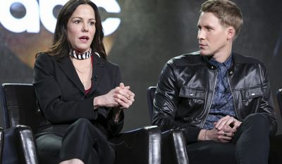 "Mary-Louise Parker, left, and Dustin Lance Black speak at the ""When We Rise"" panel at the Disney/ABC portion of the 2017 Winter Television Critics Association press tour on Tuesday, Jan. 10, 2017, in Pasadena, Calif. (Photo by Rich Fury/Invision/AP)"