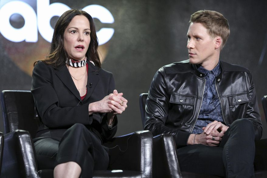 """Mary-Louise Parker, left, and Dustin Lance Black speak at the """"When We Rise"""" panel at the Disney/ABC portion of the 2017 Winter Television Critics Association press tour on Tuesday, Jan. 10, 2017, in Pasadena, Calif. (Photo by Rich Fury/Invision/AP)"""