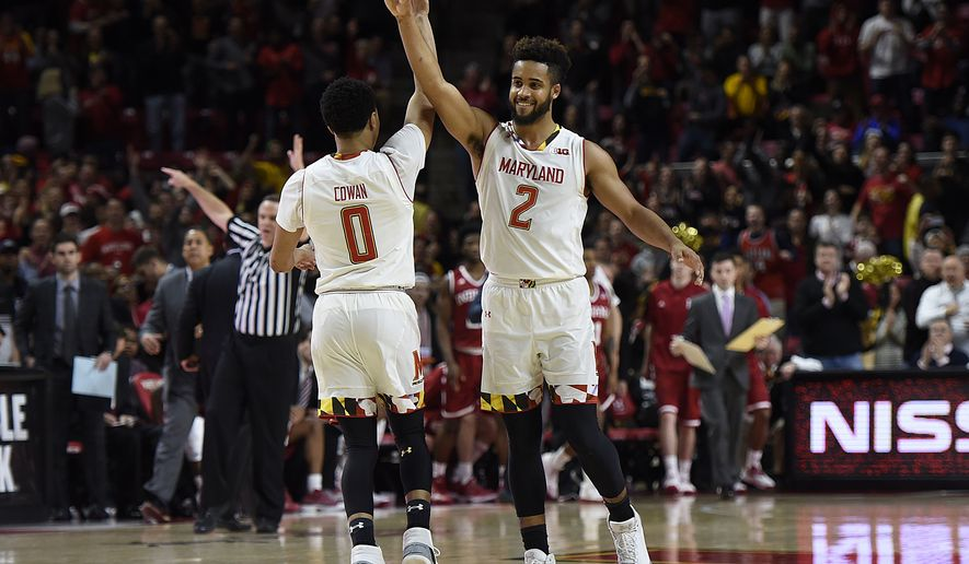 Maryland's Anthony Cowan, left, and Melo Trimble celebrate the team's 75-72 win over Indiana in an NCAA college basketball game, Tuesday, Jan. 10, 2017, in College Park, Md. (AP Photo/Gail Burton)