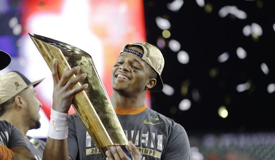 Clemson's Deshaun Watson holds up the championship trophy after the NCAA college football playoff championship game against Alabama Tuesday, Jan. 10, 2017, in Tampa, Fla. Clemson won 35-31. (AP Photo/David J. Phillip)