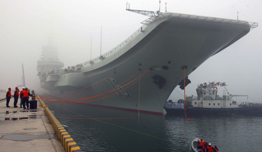 FILE - In this Feb. 27, 2013 file photo released by China's Xinhua news agency, China's first aircraft carrier, the Liaoning, is anchored in the northern port in Qingdao, east China's Shandong Province. Taiwan's defense ministry said China's sole aircraft carrier on Wednesday, Jan. 11, 2017 was transiting the Taiwan Strait amid heightened tensions between the mainland and self-governing island it claims as its own territory. (Wu Dengfeng/Xinhua via AP, File)