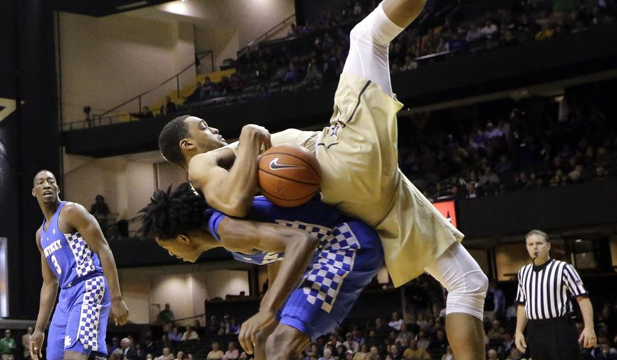 Vanderbilt forward Jeff Roberson lands on Kentucky guard De'Aaron Fox during the first half of an NCAA college basketball game Tuesday, Jan. 10, 2017, in Nashville, Tenn. (AP Photo/Mark Humphrey)