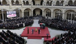 The flag draped casket of former prime minister and president of Portugal Mario Soares is carried into the Jeronimos monastery during a State Funeral ceremony in Lisbon, Portugal, Tuesday Jan. 10, 2017. Soares, who helped steer his country toward democracy after a 1974 military coup, died Saturday aged 92. (AP Photo/Armando Franca)