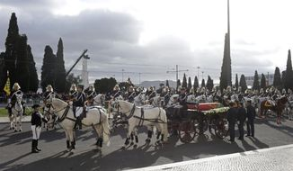 The casket of former prime minister and president of Portugal Mario Soares is carried on a horse-drawn carriage from the Jeronimos monastery after a State Funeral ceremony in Lisbon, Portugal, Tuesday Jan. 10, 2017. Soares, who helped steer his country toward democracy after a 1974 military coup, died Saturday aged 92. (AP Photo/Armando Franca)