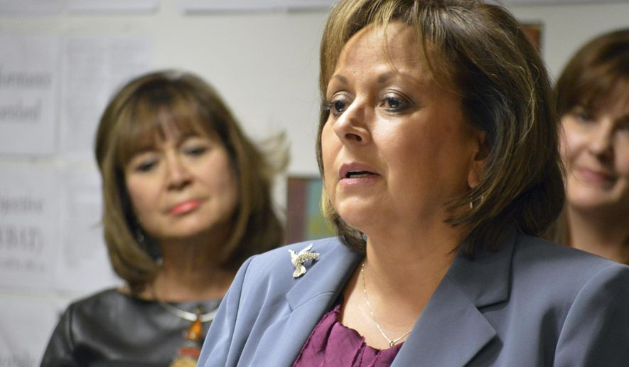 New Mexico Gov. Susana Martinez talks to reporters at the Mission Achievement and Success Charter School in Albuquerque on Tuesday, Jan. 10. 2017. The Republican governor called for further belt tightening by state government as she unveiled a budget proposal to close the state's general fund deficit and restore depleted reserves, while sticking with her vow to avoid tax increases. (AP Photo/Russell Contreras)