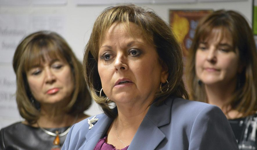New Mexico Gov. Susana Martinez talks to reporters at the Mission Achievement and Success Charter School in Albuquerque on Tuesday, Jan. 10, 2017. The Republican governor called for further belt tightening by state government as she unveiled a budget proposal to close the state's general fund deficit and restore depleted reserves, while sticking with her vow to avoid tax increases. (AP Photo/Russell Contreras)