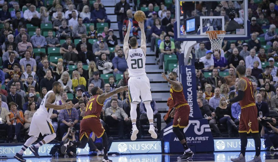 Utah Jazz forward Gordon Hayward (20) shoots as Cleveland Cavaliers guard DeAndre Liggins (14) defends in the first half during an NBA basketball game Tuesday, Jan. 10, 2017, in Salt Lake City. (AP Photo/Rick Bowmer)