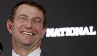 Clemson head coach Dabo Swinney laughs during an NCAA college football news conference Tuesday, Jan. 10, 2017, in Tampa, Fla. Clemson defeated Alabama 35-31 in the College Football Playoff National Championship Game the night before. (AP Photo/Chris O'Meara)