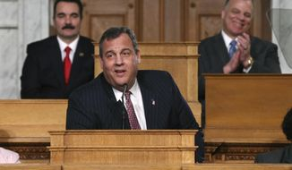 Vincent Prieto, left, Speaker of the New Jersey General Assembly and Steve Sweeney, right, New Jersey Senate President smile as New Jersey Gov. Chris Christie makes a joke about publishing a book, as he stands in the Assembly chamber of the Statehouse while delivering his State Of The State address Tuesday, Jan. 10, 2017, in Trenton, N.J. (AP Photo/Mel Evans)