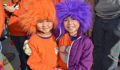 Meredith Vinson, left, and her sister Sarah wait for Clemson players to arrive, Tuesday, Jan. 10, 2017, in Clemson, S.C., the day after the Tigers defeated Alabama 35-31 in the College Football Playoff championship NCAA college football game in Tampa, Fla. (AP Photo/Richard Shiro)