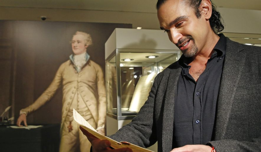 """CORRECTS NAME OF SON FROM PATRICK TO PHILIP- Javier Munoz, who plays Alexander Hamilton in the hit Broadway musical, tears up as he reads a letter from Hamilton's son Philip to his father that starts with the words """"Dear Papa,"""" Tuesday, Jan. 10, 2017, in New York. The letter is among a trove of artifacts related to Alexander Hamilton, including love letters to his wife, Eliza, will be offered up for auction at Sotheby's Jan. 18.  (AP Photo/Kathy Willens)"""