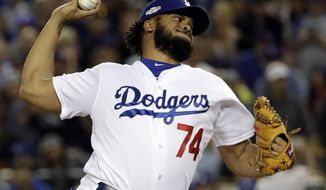 FILE - In this Oct. 18, 2016, file photo, Los Angeles Dodgers relief pitcher Kenley Jansen throws during the eighth inning of Game 3 of the National League baseball championship series against the Chicago Cubs in Los Angeles. Jansen is coming back to close games for the Los Angeles Dodgers after finalizing an $80 million, five-year contract, the team announced Tuesday, Jan. 10, 2017. (AP Photo/David J. Phillip, File)