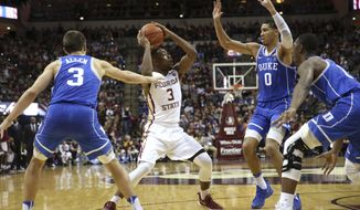 Florida State's Trent Forrest (3) is surrounded by Duke defenders Grayson Allen, left, and Jayson Tatum during the first half of an NCAA college basketball game, Tuesday, Jan. 10, 2017 in Tallahassee, Fla. (Joe Rondone/Tallahassee Democrat via AP)
