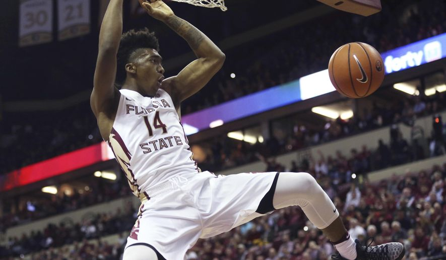 Florida State's Terance Mann (14) dunks the ball against Duke during the first half of an NCAA college basketball game, Tuesday, Jan. 10, 2017 in Tallahassee, Fla. (Joe Rondone/Tallahassee Democrat via AP)