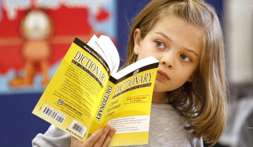 "In this Nov. 29, 2016 photo, Erin Egan, a third grade student listens to retired  attorney Ted Utchen who donated dictionaries to students at Park View Elementary School in Glen Ellyn, Ill. Utchen began his crusade against bad grammar roughly 14 years ago, and since then his quest really hasn't changed. ""The Dictionary Man"" brings little shtick to the vocabulary lesson he repeats every year for students in schools across DuPage County.(Daniel White/Daily Herald, via AP)"