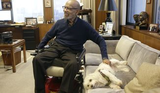 U.S. District Court Judge Thelton Henderson pets his dog Missy while interviewed in his chambers in San Francisco, Tuesday, Jan. 10, 2017. Henderson, the first African-American attorney in the Justice Department's civil rights division, says he knows there will be more civil rights battles under the Trump administration, but at 83, he no longer has the energy to fight them. (AP Photo/Jeff Chiu)